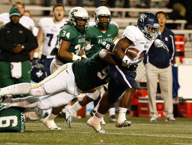 Nov 21, 2013; Birmingham, AL, USA;  Rice Owls running back Jawon Davis (3) is grabbed from behind by UAB Blazers offensive lineman Aaron Green (98) at Legion Field. The Owls defeated the Blazers 37-34 in overtime. Mandatory Credit: Marvin Gentry-USA TODAY Sports