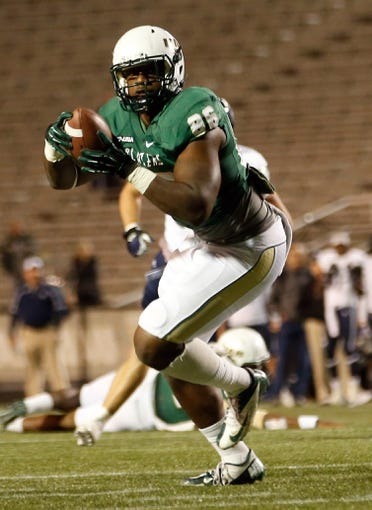 Nov 21, 2013; Birmingham, AL, USA;  UAB Blazers tight end Kennard Backman (86) carries the ball after catching a pass against the Rice Owls at Legion Field. The Owls defeated the Blazers 37-34 in overtime. Mandatory Credit: Marvin Gentry-USA TODAY Sports