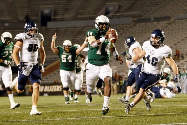 Nov 21, 2013; Birmingham, AL, USA;  UAB Blazers quarterback Jonathan Perry (14) scores against the Rice Owls at Legion Field. The Owls defeated the Blazers 37-34 in overtime. Mandatory Credit: Marvin Gentry-USA TODAY Sports