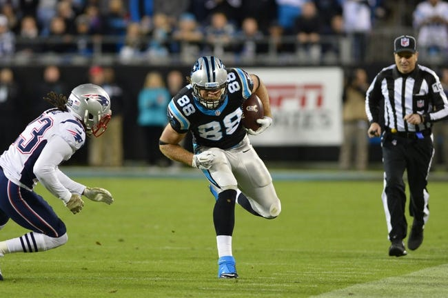 Nov 18, 2013; Charlotte, NC, USA; Carolina Panthers tight end Greg Olsen (88) with the ball as New England Patriots defensive back Marquice Cole (23) defends in the fourth quarter. The Panthers defeated the Patriots 24-20 at Bank of America Stadium. Mandatory Credit: Bob Donnan-USA TODAY Sports
