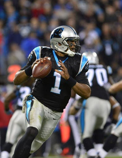 Nov 18, 2013; Charlotte, NC, USA; Carolina Panthers quarterback Cam Newton (1) looks to pass in the third quarter. The Panthers defeated the Patriots 24-20 at Bank of America Stadium. Mandatory Credit: Bob Donnan-USA TODAY Sports