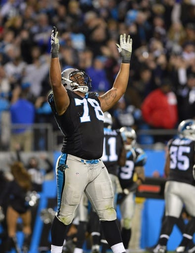 Nov 18, 2013; Charlotte, NC, USA; Carolina Panthers guard Nate Chandler (78) reacts after the Panthers score in the fourth quarter. The Panthers defeated the Patriots 24-20 at Bank of America Stadium. Mandatory Credit: Bob Donnan-USA TODAY Sports