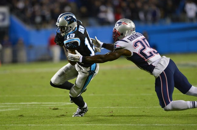 Nov 18, 2013; Charlotte, NC, USA; Carolina Panthers wide receiver Ted Ginn (19) breaks a tackle and scores the winning touchdown in the fourth quarter as New England Patriots cornerback Kyle Arrington (25) defends. The Panthers defeated the Patriots 24-20 at Bank of America Stadium. Mandatory Credit: Bob Donnan-USA TODAY Sports