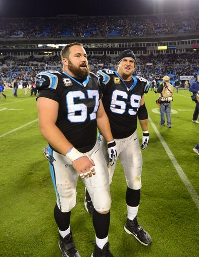 Nov 18, 2013; Charlotte, NC, USA; Carolina Panthers center Ryan Kalil (67) and tackle Jordan Gross (69) walk off the field after the game. The Panthers defeated the Patriots 24-20 at Bank of America Stadium. Mandatory Credit: Bob Donnan-USA TODAY Sports