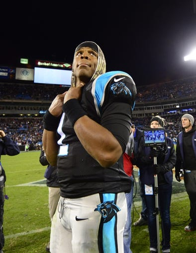 Nov 18, 2013; Charlotte, NC, USA; Carolina Panthers quarterback Cam Newton (1) on the field after the game. The Panthers defeated the Patriots 24-20 at Bank of America Stadium. Mandatory Credit: Bob Donnan-USA TODAY Sports