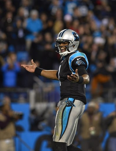 Nov 18, 2013; Charlotte, NC, USA; Carolina Panthers quarterback Cam Newton (1) reacts after throwing the game winning touchdown to wide receiver Ted Ginn (19) (not pictured) in the fourth quarter. The Panthers defeated the Patriots 24-20 at Bank of America Stadium. Mandatory Credit: Bob Donnan-USA TODAY Sports