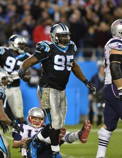 Nov 18, 2013; Charlotte, NC, USA; Carolina Panthers defensive end Charles Johnson (95) reacts after pressuring Tom Brady in the fourth quarter. The Panthers defeated the Patriots 24-20 at Bank of America Stadium. Mandatory Credit: Bob Donnan-USA TODAY Sports