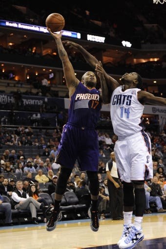 Nov 22, 2013; Charlotte, NC, USA; Phoenix Suns forward guard P.J. Tucker (17) drives to the basket as he is defended by Charlotte Bobcats forward Michael Kidd-Gilchrist (14) during the first half in the game at Time Warner Cable Arena. Mandatory Credit: Sam Sharpe-USA TODAY Sports