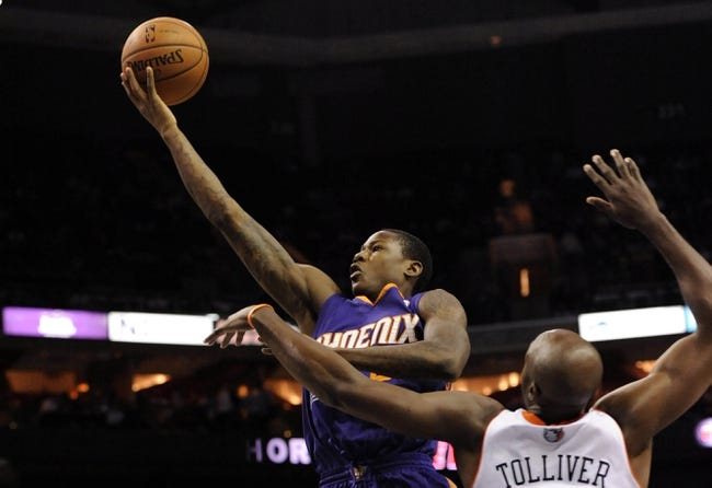 Nov 22, 2013; Charlotte, NC, USA; Phoenix Suns guard Archie Goodwin (20) drives past Charlotte Bobcats forward Anthony Tolliver (43) during the first half of the game at Time Warner Cable Arena. Mandatory Credit: Sam Sharpe-USA TODAY Sports