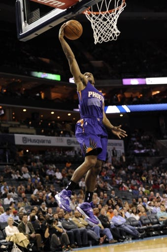Nov 22, 2013; Charlotte, NC, USA; Phoenix Suns guard Ish Smith (3) drives to the basket and scores during the first half of the game against the Charlotte Bobcats at Time Warner Cable Arena. Mandatory Credit: Sam Sharpe-USA TODAY Sports