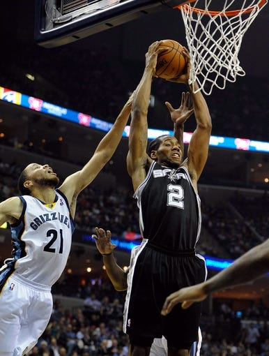Nov 22, 2013; Memphis, TN, USA; San Antonio Spurs small forward Kawhi Leonard (2) fights for a rebound against Memphis Grizzlies small forward Tayshaun Prince (21) during the second quarter at FedExForum. Mandatory Credit: Justin Ford-USA TODAY Sports