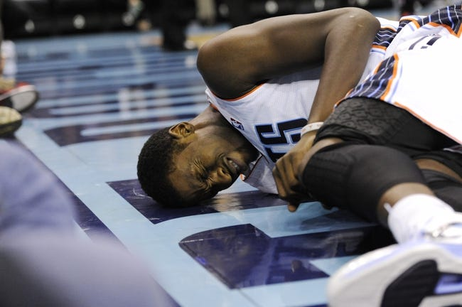 Nov 22, 2013; Charlotte, NC, USA; Charlotte Bobcats forward Michael Kidd-Gilchrist (14) takes a hard fall and lays on the floor during the second half of the game against the Phoenix Suns at Time Warner Cable Arena. Suns win 98-91. Mandatory Credit: Sam Sharpe-USA TODAY Sports
