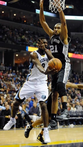 Nov 22, 2013; Memphis, TN, USA; Memphis Grizzlies shooting guard Tony Allen (9) passes the ball against San Antonio Spurs power forward Tim Duncan (21) during the third quarter at FedExForum. Mandatory Credit: Justin Ford-USA TODAY Sports