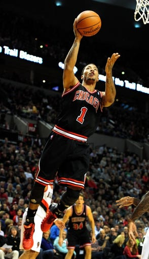 Nov 22, 2013; Portland, OR, USA; Chicago Bulls point guard Derrick Rose (1) drives to the basket during the first quarter of the game against the Portland Trail Blazers at the Moda Center. Mandatory Credit: Steve Dykes-USA TODAY Sports