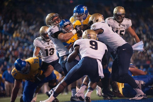 Nov 22, 2013; San Jose, CA, USA; San Jose State Spartans running back Jarrod Lawson (40) rushes for a touchdown against Navy Midshipmen linebacker Cody Peterson (53) and cornerback Myer Krah (9) during the second quarter at Spartan Stadium. Mandatory Credit: Ed Szczepanski-USA TODAY Sports