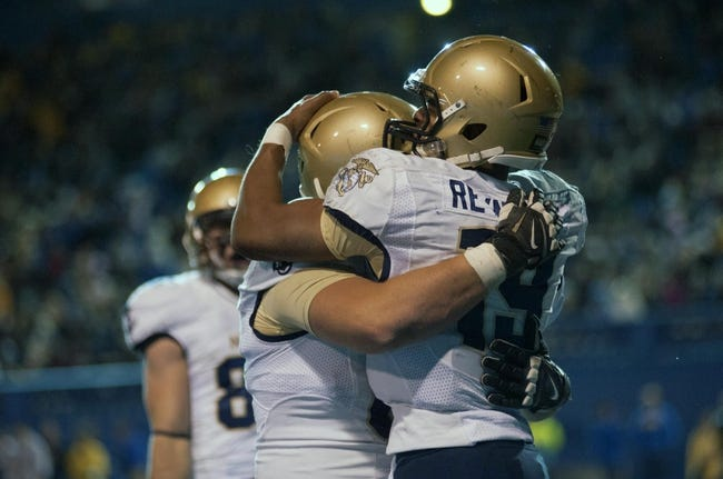 Nov 22, 2013; San Jose, CA, USA; Navy Midshipmen quarterback Keenan Reynolds (19) and offensive tackle Bradyn Heap (62) celebrate after scoring a touchdown against the San Jose State Spartans during the second quarter at Spartan Stadium. Mandatory Credit: Ed Szczepanski-USA TODAY Sports