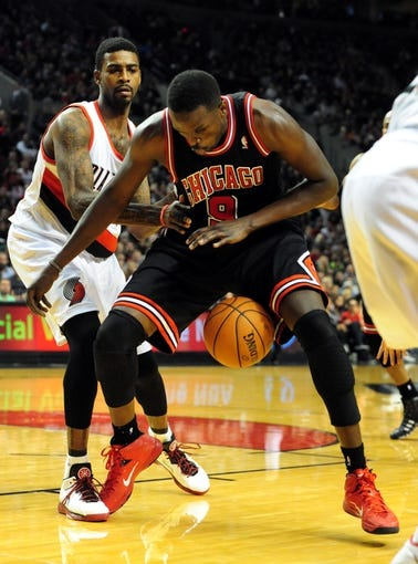 Nov 22, 2013; Portland, OR, USA; Chicago Bulls small forward Luol Deng (9)loses control of the ball during the fourth quarter of the game against the Portland Trail Blazers at the Moda Center. The Blazers won the game 98-95. Mandatory Credit: Steve Dykes-USA TODAY Sports