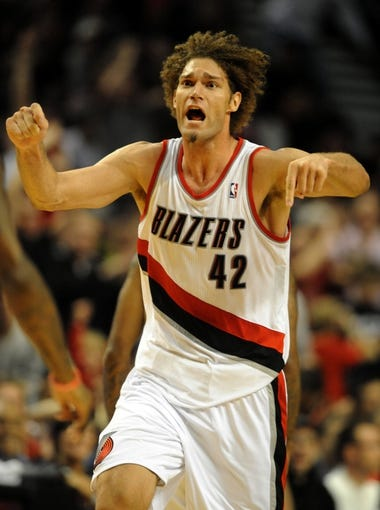 Nov 22, 2013; Portland, OR, USA; Portland Trail Blazers center Robin Lopez (42) signals to his teammates during the third quarter of the game against the Chicago Bulls at the Moda Center. The Blazers won the game 98-95. Mandatory Credit: Steve Dykes-USA TODAY Sports