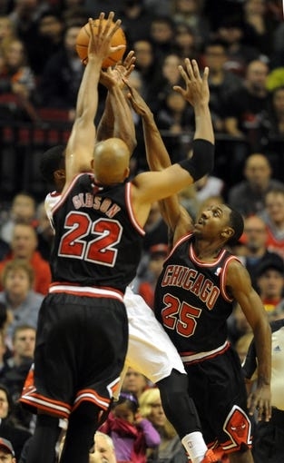 Nov 22, 2013; Portland, OR, USA; Portland Trail Blazers shooting guard Wesley Matthews (2) shoots while being guarded by Chicago Bulls power forward Taj Gibson (22) and point guard Marquis Teague (25) during the fourth quarter of the game at the Moda Center. The Blazers won the game 98-95. Mandatory Credit: Steve Dykes-USA TODAY Sports