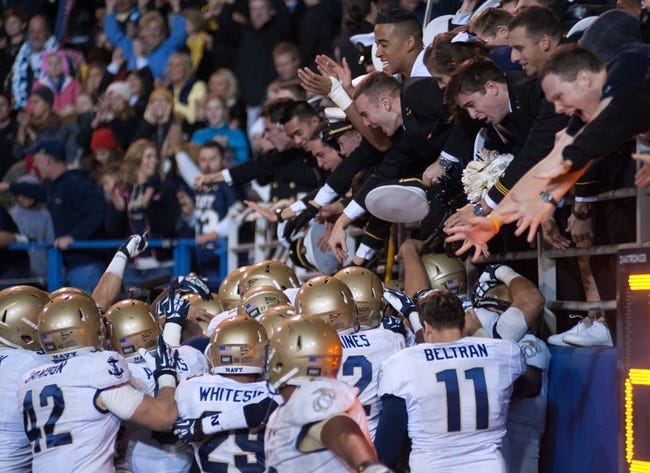 Nov 22, 2013; San Jose, CA, USA; The Navy Midshipmen celebrate with the crowd after defeating the San Jose State Spartans in triple overtime at Spartan Stadium. Mandatory Credit: Ed Szczepanski-USA TODAY Sports
