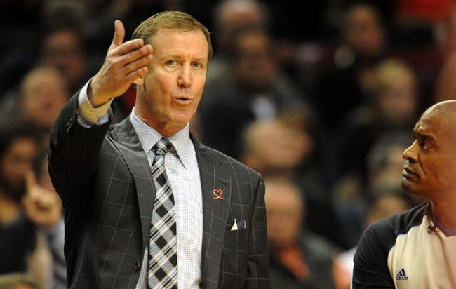 Nov 22, 2013; Portland, OR, USA; Portland Trail Blazers head coach Terry Stotts has some words with referee Derrick Collins (11) during the fourth quarter of the game at the Moda Center. The Blazers won the game 98-95. Mandatory Credit: Steve Dykes-USA TODAY Sports