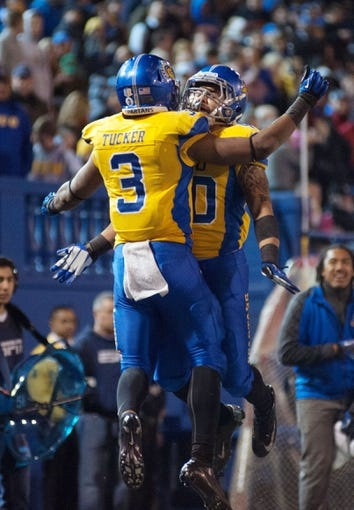 Nov 22, 2013; San Jose, CA, USA; San Jose State Spartans running back Thomas Tucker (3) celebrates with running back Jarrod Lawson (40) after scoring a touchdown against the Navy Midshipmen during the second overtime at Spartan Stadium. Navy won 58-52 in triple overtime. Mandatory Credit: Ed Szczepanski-USA TODAY Sports