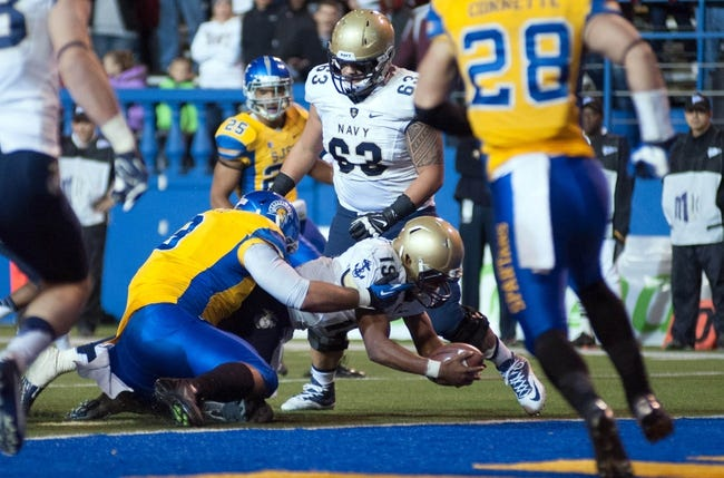 Nov 22, 2013; San Jose, CA, USA; Navy Midshipmen quarterback Keenan Reynolds (19) rushes for a touchdown against the San Jose State Spartans during the first overtime at Spartan Stadium. The Navy Midshipmen defeated the San Jose State Spartans 58-52 in triple overtime. Mandatory Credit: Ed Szczepanski-USA TODAY Sports
