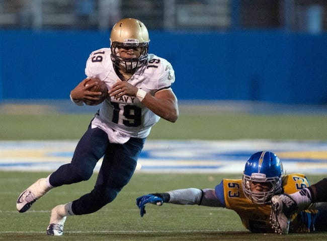 Nov 22, 2013; San Jose, CA, USA; Navy Midshipmen quarterback Keenan Reynolds (19) rushes for a gain against the San Jose State Spartans during the third quarter at Spartan Stadium. Navy won 58-52 in triple overtime. Mandatory Credit: Ed Szczepanski-USA TODAY Sports