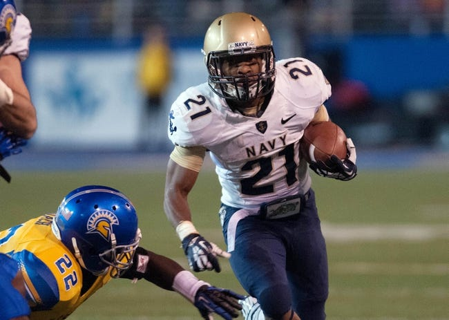 Nov 22, 2013; San Jose, CA, USA; Navy Midshipmen running back DeBrandon Sanders (21) rushes for a gain against the San Jose State Spartans during the third quarter at Spartan Stadium. Navy won 58-52 in triple overtime. Mandatory Credit: Ed Szczepanski-USA TODAY Sports