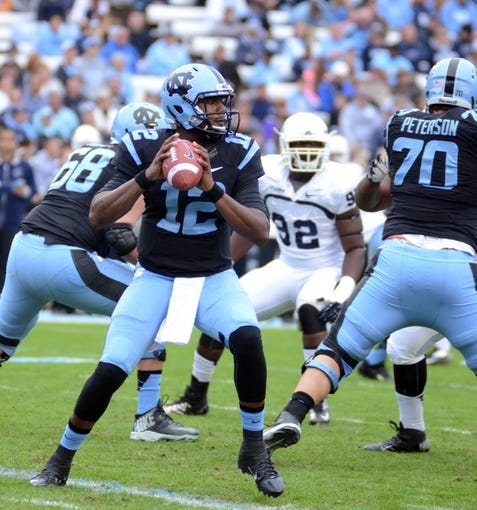 Nov 23, 2013; Chapel Hill, NC, USA; North Carolina Tar Heels quarterback Marquise Williams (12) drops back to pass against the Old Dominion Monarchs during the first half at Kenan Memorial Stadium. Mandatory Credit: Rob Kinnan-USA TODAY Sports