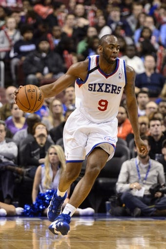 Nov 20, 2013; Philadelphia, PA, USA; Philadelphia 76ers guard James Anderson (9) brings the ball up court during the third quarter against the Toronto Raptors at Wells Fargo Center. The Raptors defeated the Sixers 108-98. Mandatory Credit: Howard Smith-USA TODAY Sports