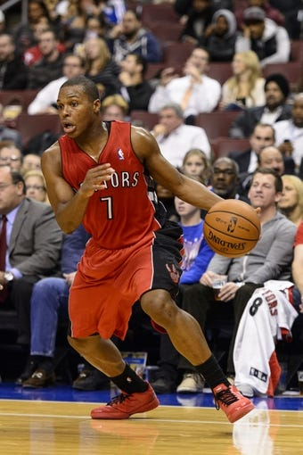 Nov 20, 2013; Philadelphia, PA, USA; Toronto Raptors guard Kyle Lowry (7) during the third quarter against the Philadelphia 76ers at Wells Fargo Center. The Raptors defeated the Sixers 108-98. Mandatory Credit: Howard Smith-USA TODAY Sports