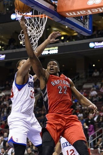 Nov 20, 2013; Philadelphia, PA, USA; Toronto Raptors forward Rudy Gay (22) shoots under pressure from Philadelphia 76ers center Daniel Orton (33) during the second quarter at Wells Fargo Center. The Raptors defeated the Sixers 108-98. Mandatory Credit: Howard Smith-USA TODAY Sports