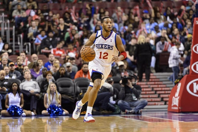 Nov 20, 2013; Philadelphia, PA, USA; Philadelphia 76ers guard Evan Turner (12) brings the ball up court during the fourth quarter against the Toronto Raptors at Wells Fargo Center. The Raptors defeated the Sixers 108-98. Mandatory Credit: Howard Smith-USA TODAY Sports