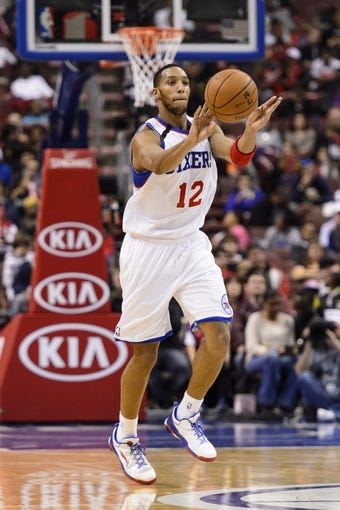 Nov 20, 2013; Philadelphia, PA, USA; Philadelphia 76ers guard Evan Turner (12) passes the ball during the fourth quarter against the Toronto Raptors at Wells Fargo Center. The Raptors defeated the Sixers 108-98. Mandatory Credit: Howard Smith-USA TODAY Sports