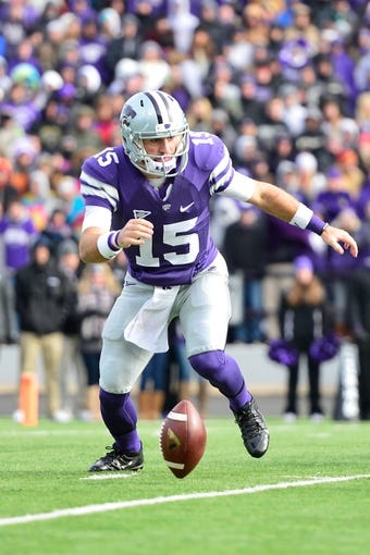 Nov 23, 2013; Manhattan, KS, USA; Kansas State Wildcats quarterback Jake Waters (15) fumbles the snap against the Oklahoma Sooners during the first half at Bill Snyder Family Stadium. Mandatory Credit: Jasen Vinlove-USA TODAY Sports