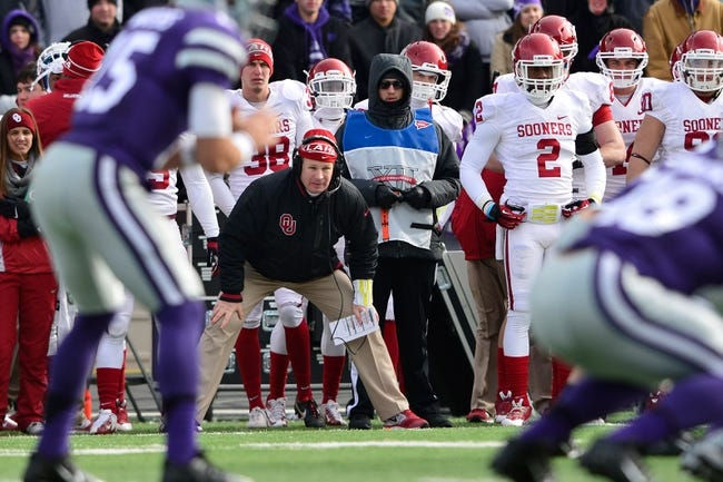 Nov 23, 2013; Manhattan, KS, USA; Oklahoma Sooners head coach Bob Stoops watches the game between the Kansas State Wildcats and the Oklahoma Sooners during the first half at Bill Snyder Family Stadium. Mandatory Credit: Jasen Vinlove-USA TODAY Sports