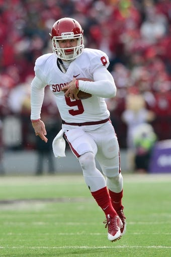Nov 23, 2013; Manhattan, KS, USA; Oklahoma Sooners quarterback Trevor Knight (9) runs the ball against the Kansas State Wildcats during the first half at Bill Snyder Family Stadium. Mandatory Credit: Jasen Vinlove-USA TODAY Sports