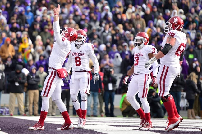 Nov 23, 2013; Manhattan, KS, USA; Oklahoma Sooners quarterback Trevor Knight (9) celebrates after scoring a touchdown against the Kansas State Wildcats during the first half at Bill Snyder Family Stadium. Mandatory Credit: Jasen Vinlove-USA TODAY Sports