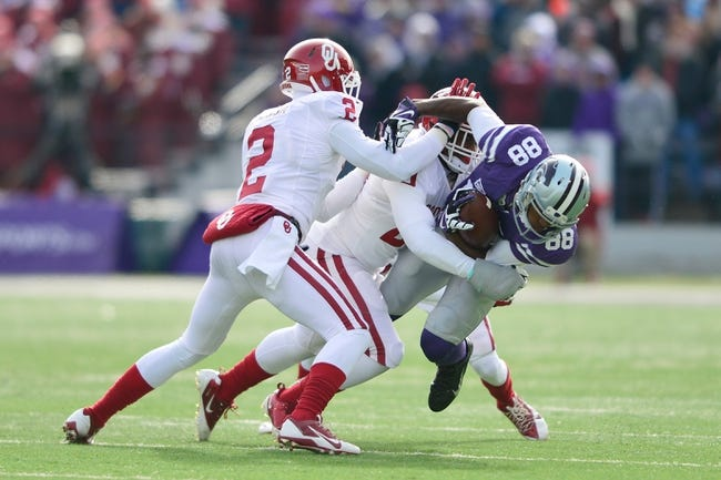 Nov 23, 2013; Manhattan, KS, USA; Kansas State Wildcats wide receiver Torell Miller (88) is tackled by Oklahoma Sooners linebacker Frank Shannon (20) and defensive back Julian Wilson (2) during the first half at Bill Snyder Family Stadium. Mandatory Credit: Jasen Vinlove-USA TODAY Sports