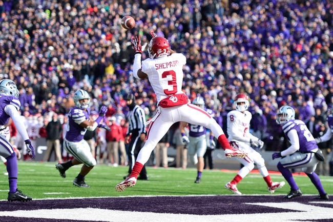 Nov 23, 2013; Manhattan, KS, USA; Oklahoma Sooners wide receiver Sterling Shepard (3) catches a pass for a touchdown against the Kansas State Wildcats during the first half at Bill Snyder Family Stadium. Mandatory Credit: Jasen Vinlove-USA TODAY Sports