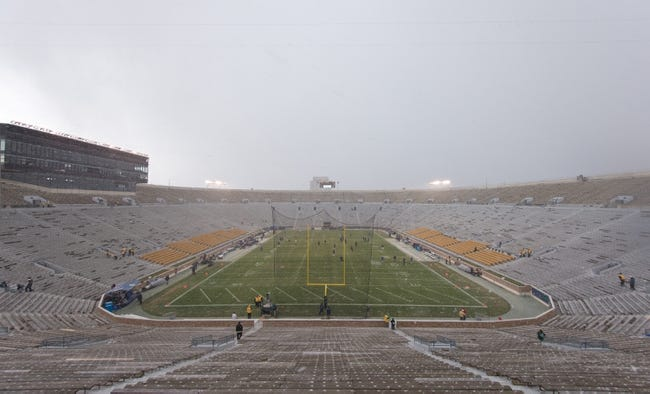 Nov 23, 2013; South Bend, IN, USA; Snow falls on Notre Dame Stadium before the game between the BYU Cougars and the Notre Dame Fighting Irish. Mandatory Credit: Matt Cashore-USA TODAY Sports
