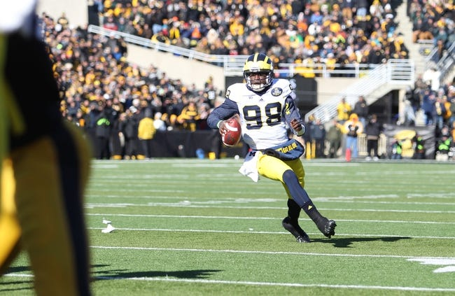 Nov 23, 2013; Iowa City, IA, USA;  Michigan Wolverines quarterback Devin Gardner (98) rolls out against the Iowa Hawkeyes at Kinnick Stadium. Mandatory Credit: Reese Strickland-USA TODAY Sports