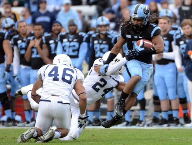 Nov 23, 2013; Chapel Hill, NC, USA; North Carolina Tar Heels running back Khris Francis (1) runs the ball as Old Dominion Monarchs safety Fellonte Misher (24) makes the tackle during the first half at Kenan Memorial Stadium. Mandatory Credit: Rob Kinnan-USA TODAY Sports