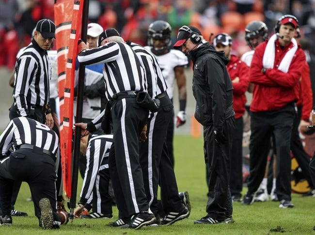 Nov 23, 2013; Houston, TX, USA; Cincinnati Bearcats head coach Tommy Tuberville watches officials make a measurement during the first quarter against the Houston Cougars at BBVA Compass Stadium. Mandatory Credit: Troy Taormina-USA TODAY Sports