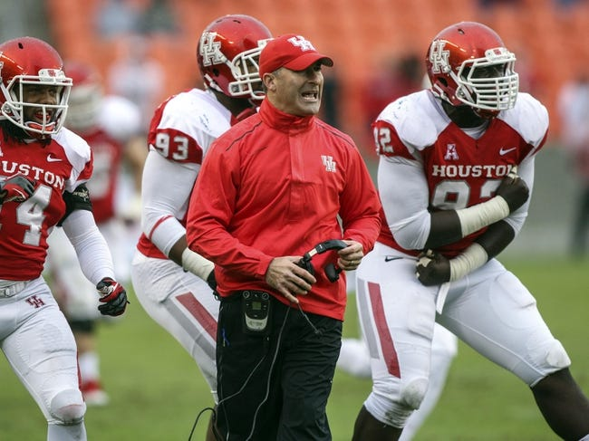 Nov 23, 2013; Houston, TX, USA; Houston Cougars head coach Tony Levine reacts after the Cougars make a defensive stop during the first quarter against the Cincinnati Bearcats at BBVA Compass Stadium. Mandatory Credit: Troy Taormina-USA TODAY Sports
