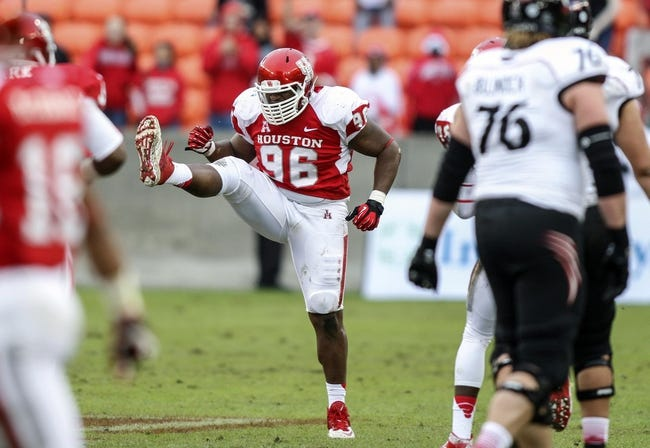 Nov 23, 2013; Houston, TX, USA; Houston Cougars defensive lineman Jeremiah Farley (96) reacts after making a sack during the first quarter against the Cincinnati Bearcats at BBVA Compass Stadium. Mandatory Credit: Troy Taormina-USA TODAY Sports