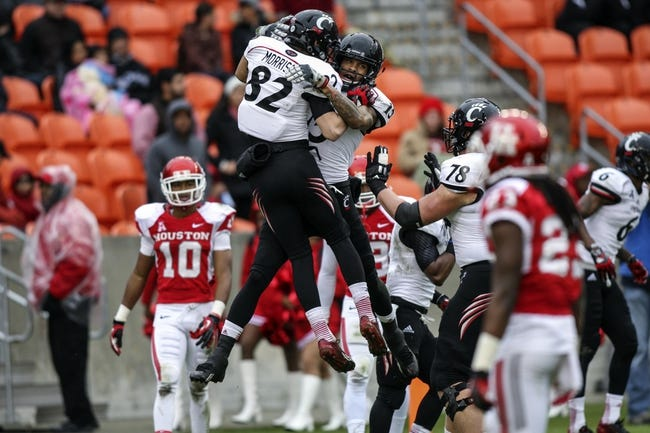 Nov 23, 2013; Houston, TX, USA; Cincinnati Bearcats wide receiver Chris Moore (15) and wide receiver Max Morrison (82) celebrate after Moore scores a touchdown during the second quarter against the Houston Cougars at BBVA Compass Stadium. Mandatory Credit: Troy Taormina-USA TODAY Sports