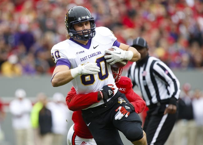 Nov 23, 2013; Raleigh, NC, USA; East Carolina Pirates wide receiver Bryce Williams (80) runs with the ball after his 2nd quarter catch against the North Carolina State Wolfpack at Carter Finley Stadium. Mandatory Credit: James Guillory-USA TODAY Sports