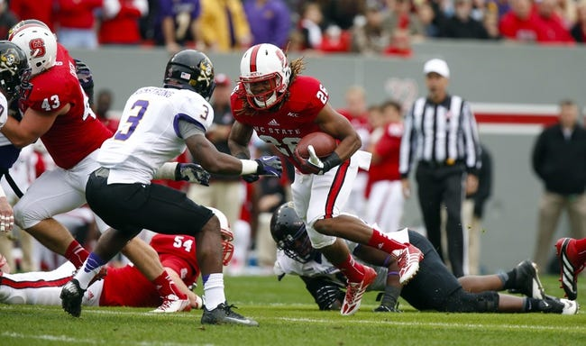 Nov 23, 2013; Raleigh, NC, USA; North Carolina State Wolfpack running back Tony Creecy (26) carries the ball during the 2nd quarter against the East Carolina Pirates at Carter Finley Stadium. Mandatory Credit: James Guillory-USA TODAY Sports